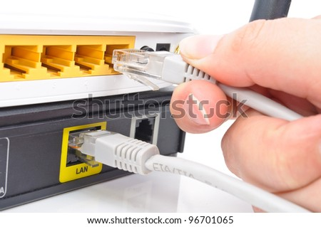 Connect the cable to the network switch. Close-up Photos