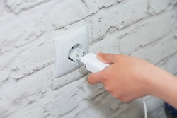connect the charger to a wall outlet. Save energy-unplug the charger.