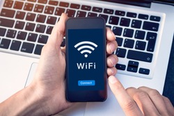 Connect to WiFi wireless internet network with smartphone at coffee shop or hotel with button on mobile device screen, free public hotspot secure access to web for email and website browsing