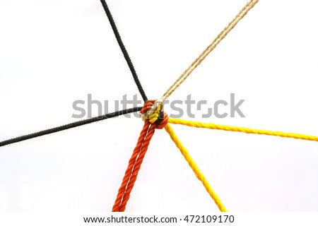 Connected group concept as many different ropes tied and linked together as an unbreakable chain as a community trust and faith metaphor