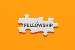 Connected puzzle pieces with the word fellowship. Cooperation, partnership, solidarity and support in business concept.