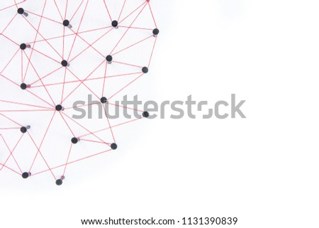 Connecting networks concept - network connected with yarn red on white paper with copy space. Simulator connection social media, internet, people communication, Linking entities #1131390839