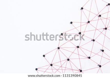Connecting networks concept - network connected with yarn red on white paper with copy space. Simulator connection social media, internet, people communication, Linking entities #1131390845