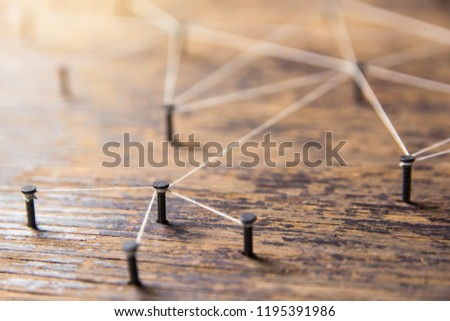 Connecting networks concept - network connected with yarn white on Plank wood with copy space. Simulator connection social media, internet, people communication, Linking entities #1195391986