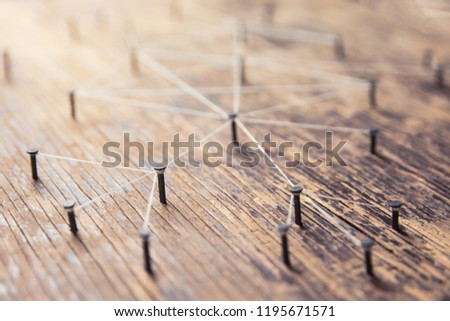 Connecting networks concept - network connected with yarn white on Plank wood with copy space. Simulator connection social media, internet, people communication, Linking entities #1195671571