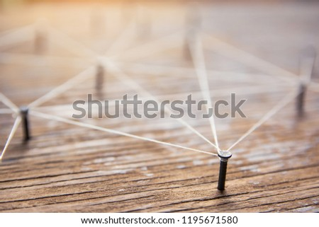 Connecting networks concept - network connected with yarn white on Plank wood with copy space. Simulator connection social media, internet, people communication, Linking entities #1195671580