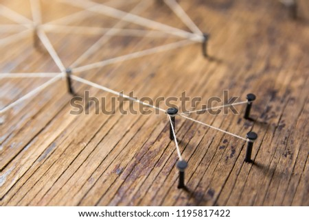 Connecting networks concept - network connected with yarn white on Plank wood with copy space. Simulator connection social media, internet, people communication, Linking entities #1195817422