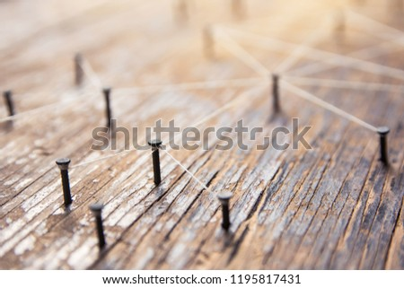 Connecting networks concept - network connected with yarn white on Plank wood with copy space. Simulator connection social media, internet, people communication, Linking entities #1195817431