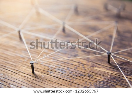 Connecting networks concept - network connected with yarn white on Plank wood with copy space. Simulator connection social media, internet, people communication, Linking entities #1202655967