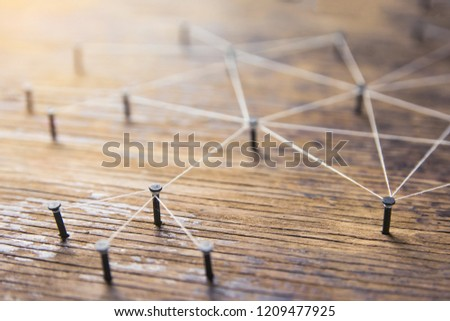 Connecting networks concept - network connected with yarn white on Plank wood with copy space. Simulator connection social media, internet, people communication, Linking entities