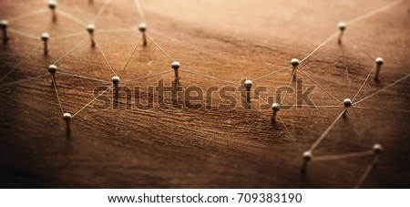Connecting networks. Two separate network being connected with gold wire. Networking, social media, internet communication abstract concept image. Web of gold wires on rustic wood. #709383190