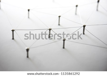 Connecting people and machines. Networking, internet infrastructure communication abstract. Entities of a network connected to each other. Web of thin silver wires on white background. #1135861292