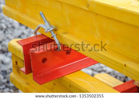 Connection of metal beams and wooden beams into one system close-up #1353502355