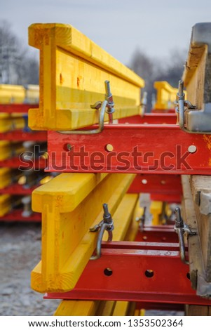 Connection of metal beams and wooden beams into one system close-up #1353502364