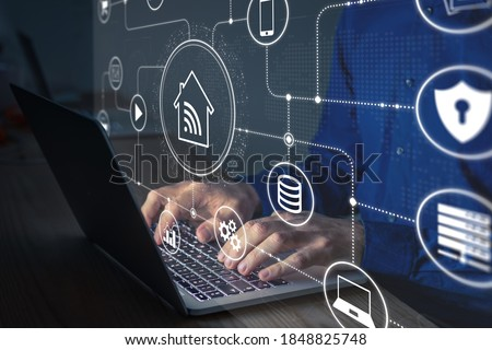 Connections and smart home technology with devices and computers connected on internet and local network, person configuring data communication and digital information security on laptop