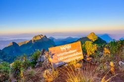 Conqueror signpost on the top of Doi Luang Chiang Dao mountain at Chiang Dao, Chiangmai Province, Thailand : TEXT TRANSLATION: