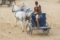 Conquest, Roman chariots in the circus arena, fighting warriors and horses