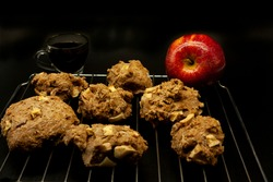 Conservative-free apple cookies with squares of natural fruit apples on grid next to a cup of black coffee
