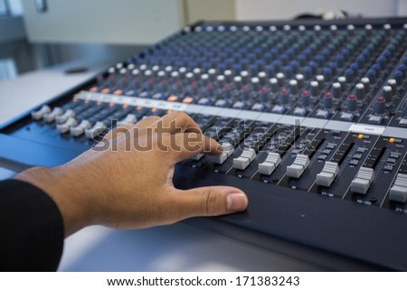 Console audio controls. Sound engineer.