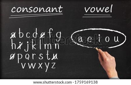 Consonant and vowel letters written on blackboard by a student Stok fotoğraf ©
