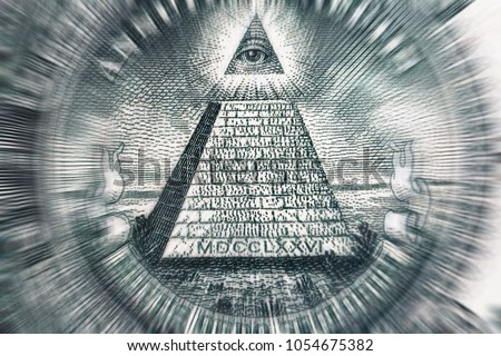 Conspiracy theory concept. All Seeing Eye and Pyramid on USA dollar banknote, macro photo with motion blur effect