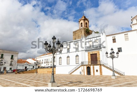 Constitution square and the facade of the church of Santa Maria de la Plaza in Fregenal de la Sierra town, province of Badajoz, Extremadura, Spain