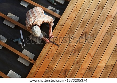 Constructing a Wooden Flooring of a Terrace Stock photo ©