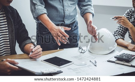 Construction and structure concept of Engineer or architect meeting for project working with partner and engineering tools on model building and blueprint in working site, contract for both companies. ストックフォト ©