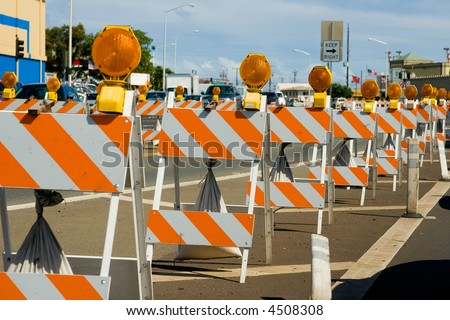 Construction barricades in a row along a road