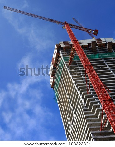Construction building with crane background with blue sky
