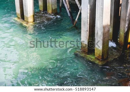 Construction cement bridge into the sea #518893147