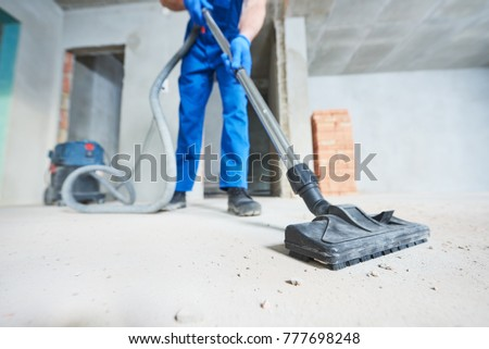 construction cleaning service. dust removal with vacuum cleaner