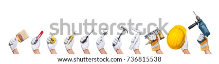 construction concept hands with all of tools supplies for home construction builder and copy space isolated on white background #736815538