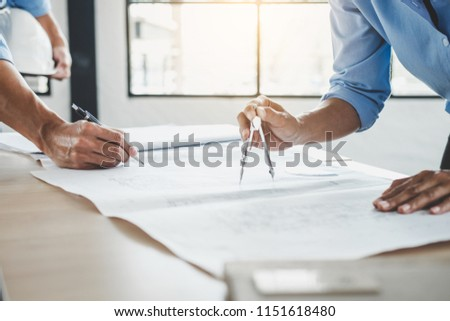 Construction concept of Engineer or architect meeting for project working with partner and engineering tools on model building and blueprint in working site. #1151618480