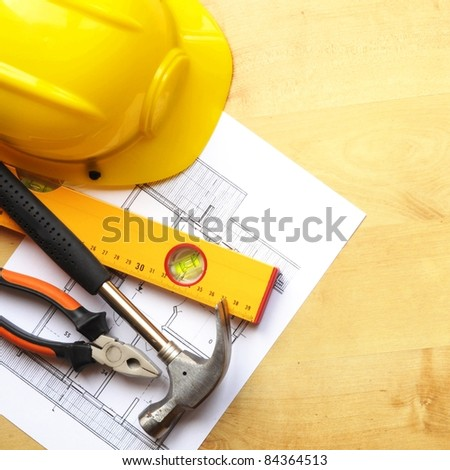 construction concept with hard hat working tools and copyspace