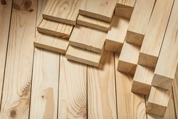 construction concept wooden timber on wood background