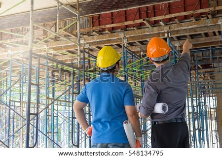 Construction concepts, Engineer and Architect working at Construction Site with blueprint #548134795