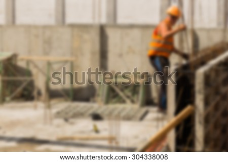 Construction, construction workers on site. blurred Background