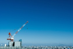 Construction crane in Japanese building against blue sky background