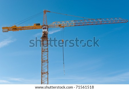 Construction crane over blue sky