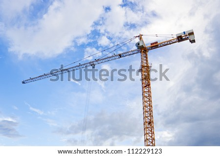 Construction crane with blue sky