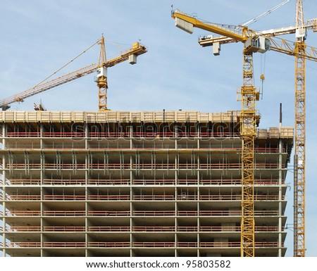 Construction cranes at a building site