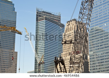 Construction cranes at work putting up high rise buildings.