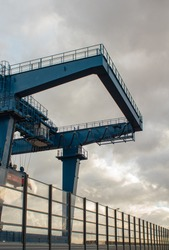 Construction cranes for coal transportation fenced