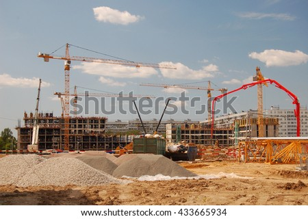 Construction cranes on a blue sky background #433665934
