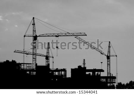 construction cranes silhouette