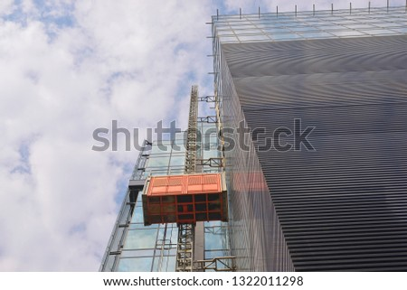 construction elevator on building #1322011298