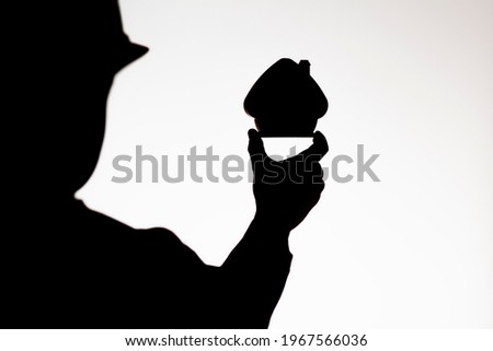 construction engineer in helmet holds small figure of house maquette on white isolated background, building industry concept Photo stock ©