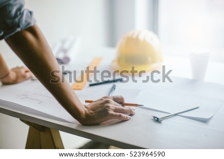 Construction engineering. Close up of engineers hands working on table