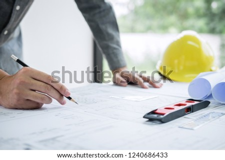 Construction engineering or architect hands working on blueprint inspection in workplace, while checking information drawing and sketching for architecture project working. #1240686433